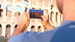 Young Tourist Taking Picture of Coliseum with Smartphone Rome Vacation Stock Footage