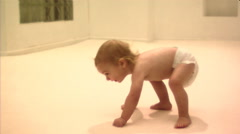 Baby getting up and walking - stock footage