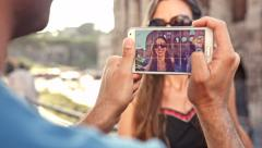 Man Taking Picture of Beautiful Young Woman Italy Vacation Smartphone Stock Footage