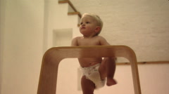 Baby playing with stool Stock Footage