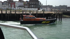 Pilot boat leaves portsmouth dock, england Stock Footage