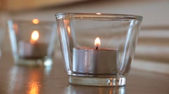 Candle Burning On Table Stock Footage