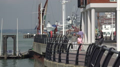 Tourists visit gunwharf quays, portsmouth, england Stock Footage