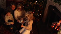 Family at Christmas putting out presents for Santa. Stock Footage