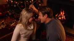Couple kissing under mistletoe at Christmas. Stock Footage