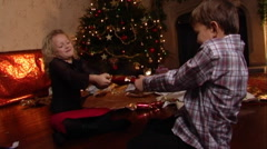 Children pulling Christmas cracker. Stock Footage