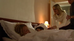Parents putting children to bed. Stock Footage