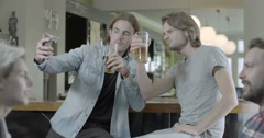 Men drinking beer Stock Footage