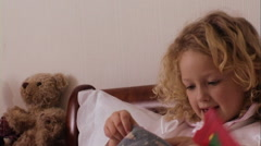 Children in bed with Christmas stocking and presents - stock footage