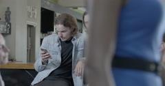 Men talking in pub Stock Footage
