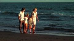 Family on beach - stock footage