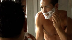 Young man shaving Stock Footage