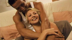 Young couple in bed - stock footage