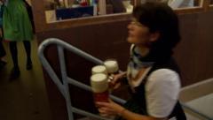 Waitress Delivering Beer at Oktoberfest Stock Footage