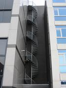 Spiral staircase to rescue building - stock photo