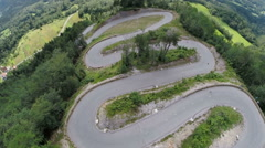 Mountain curve winding pass road - stock footage