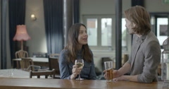 Man and woman enjoying drink Stock Footage