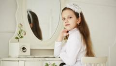 Beautiful girl preens in the mirror - dolly shot Stock Footage