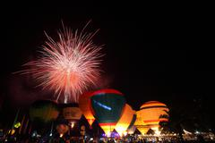 Balloon festival with fireworks Stock Photos