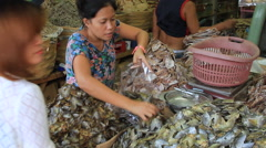 Selling dried fish heads  in outdoor market Stock Footage