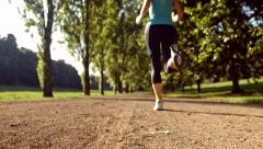 Active Young Woman Running Down Park Path Beautiful Nature Sport Jogging Fitness - stock footage