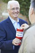 Senior man collecting money for charity Stock Photos