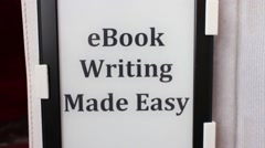 "E-BOOK: Camera Moves into e-Reader Device, ""eBook Writing Made Easy"" Stock Footage"