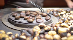 Chestnut roasted cooked street vendor trolley barbecue fast food istanbul Stock Footage