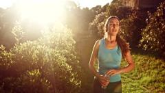 Summer Rest from Jogging Young Woman Drinking Water Bottle Tired Resting Stock Footage