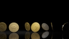 Many bitcoins spin and settle Stock Footage