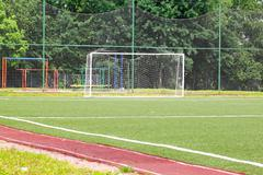 Football goal on a green field on a background Stock Photos