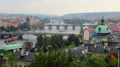 Prague view, river ships, bridges transport vehicles, flags wave Stock Footage