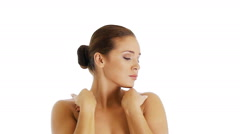 Beautiful female model touching her face - stock footage