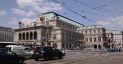 UHD 4K Tram Passing Crossing Intersection Cars Traffic Jam Vienna State Opera Stock Footage