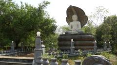 Buddha statue close to Sigiraya, lion rock and pidurangala in Sri Lanka Stock Footage