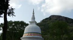 Pagoda time lapse with the Pidurangala rock at the background in Sri Lanka Stock Footage
