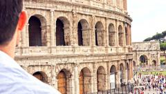 Italy Travel Tourism Rome Man Holding Map Coliseum Tourists Crowd Stock Footage