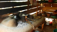 Making  Pol roti at a clay stove in Sri Lanka Stock Footage