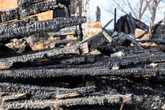 ruins and remains of a burned down house - stock photo