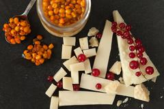 cheese, redcurrant and sea buckthorn jam - stock photo
