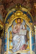 Religious orthodox icon of sitting lord jesus christ god with open bible. Kuvituskuvat