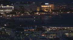 Beautiful Cannes panorama promenade traffic car famous building night nightlife  Stock Footage