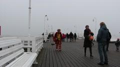 People walking along the pier in Sopot Stock Footage