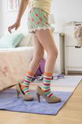 Caucasian girl wearing high heels in bedroom Stock Photos