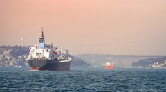 Cargo vessels cruising along Bosphorus Sea at sunset Stock Footage