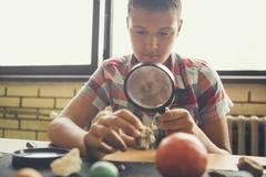 Student examining models of planets in classroom Stock Photos
