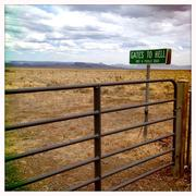 Sign for Gates to Hell in remote landscape Stock Photos
