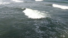 Close up shot of medium size rolling and breaking waves in the ocean - stock footage