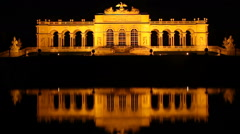 Vienna's famous Schonbrunn palace at night timelapse reflection Stock Footage