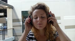 Girl Listening Music in Headphones Outdoors. Slow Motion. Stock Footage